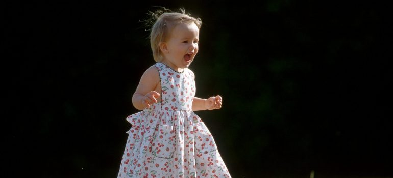 a little girl running and screaming