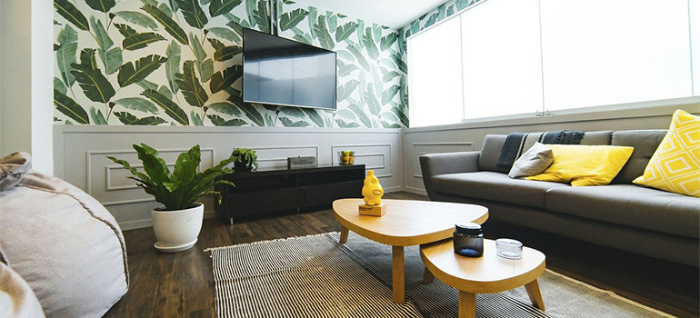 Room with leafy wallpaper