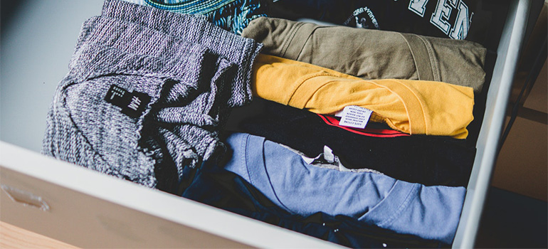 A drawer filled with folded clothes